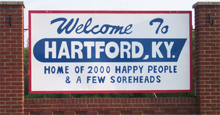 "Hartford, Kentucky Welcome sign.  ""Welcome to Hartford, KY. Home of 2000 happy people & a few soreheads."""